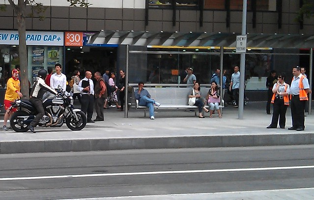 A motorcyclist intrudes at the Swanston Street tram stop/bike lane