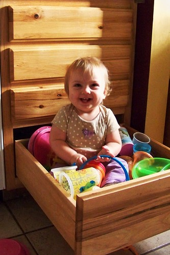 Phoebe in the drawer smiling
