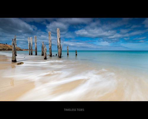 ocean wood blue sea rotting canon ruins jetty wideangle wash pylons portwillunga sthaustralia 1740lusm 5dmkii