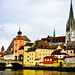 Old Stone Bridge (Steinerne Brücke) and Tower with Cathedral in Regensburg Germany