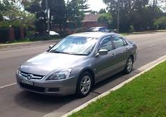automobile(1.0), automotive exterior(1.0), family car(1.0), wheel(1.0), vehicle(1.0), rim(1.0), honda(1.0), sedan(1.0), land vehicle(1.0), luxury vehicle(1.0), honda accord(1.0),