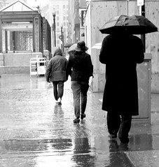 boston downtown crossing umbrellas three people