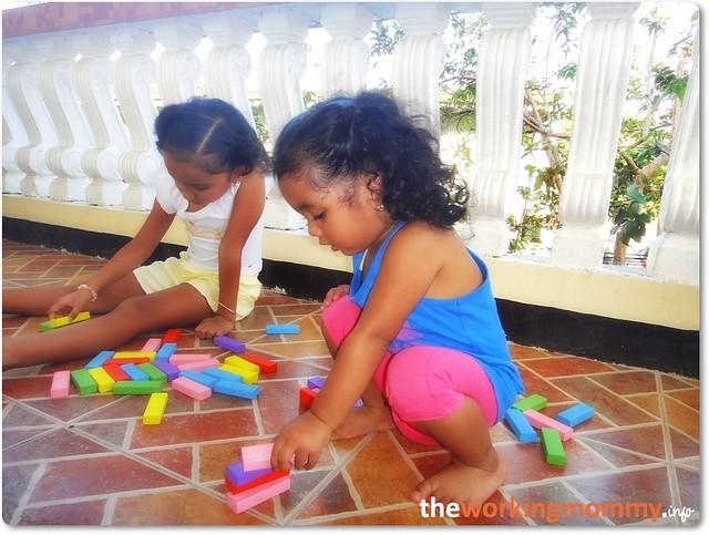 the girls building blocks