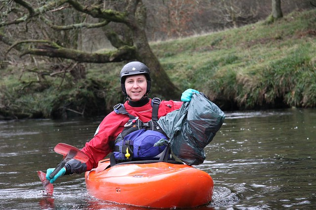 All smiles on the river with your rubbish bag