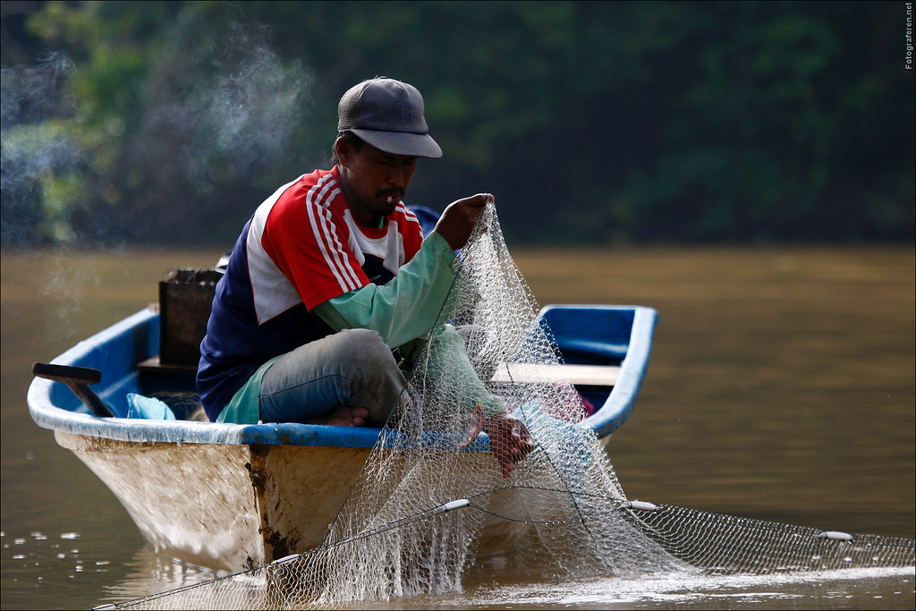 Fisherman at a Kinabatangan river oxbow