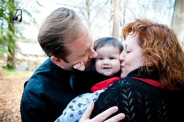 Big kisses for Alexa during our holiday photography session in Richmond, Virginia. Taken by Benson Lau Photography.