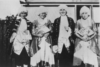 Four people dressed for a costume ball