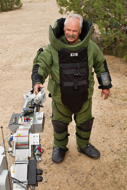 Brad Lounsbury is a bomb technician with LANL's emergency response group. He's pictured with a robot.  Prior to joining the Lab in 1997, he was an explosive ordnance disposal technician with the U.S. Navy for 23 years.  Photo by Richard Robinson