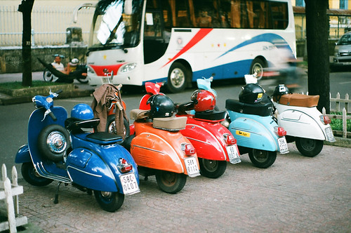 Colorful vespa in saigon. by The.Scooterist