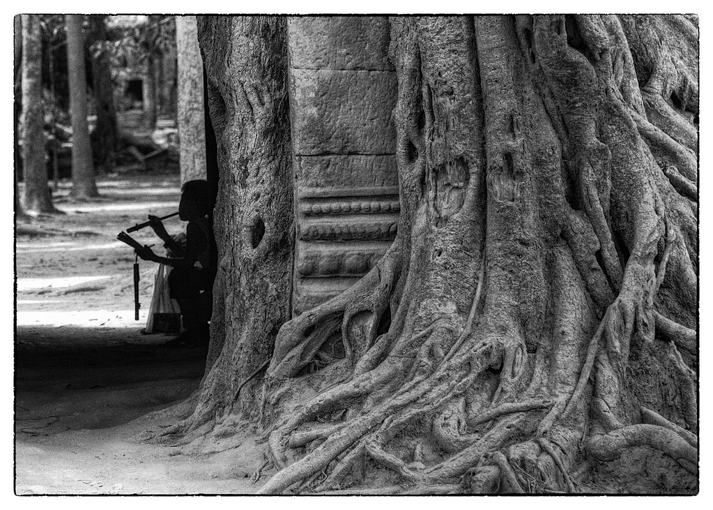 Taking a break from selling flutes, Angkor Wat, Cambodia