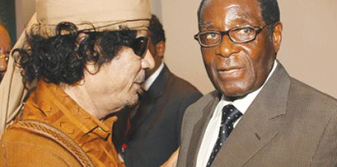 Martyred Libyan leader Muammar Gaddafi with President of Zimbabwe Robert Mugabe. Gaddafi was assassinated by US imperialism and its agents on October 20, 2011. by Pan-African News Wire File Photos