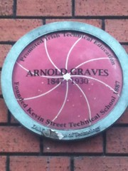 Photo of Arnold Graves purple, white and green plaque