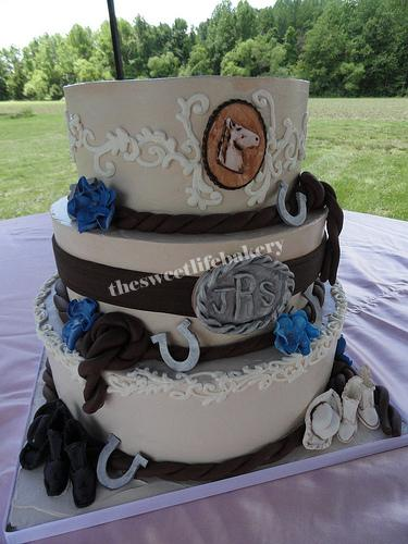 Cowboy and Cowgirl Wedding Cake All handmade sugar decorations accent this