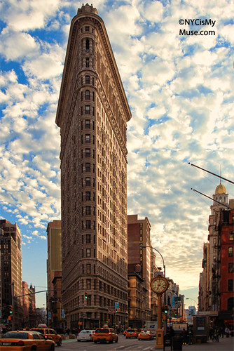 Flatiron Building, Cotton ball clouds against a blue sky