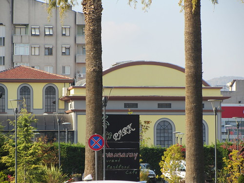 Balikesir: Old yellow building behind palm trees (1)
