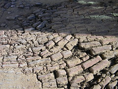 asphalt(0.0), stone wall(0.0), wall(0.0), drought(0.0), rubble(0.0), road surface(0.0), brick(0.0), flooring(0.0), soil(1.0), geology(1.0), cobblestone(1.0), rock(1.0),