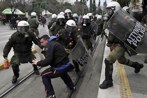 Greek riot police attack protesters during a two-day general against the imposition of austerity inside the country. A new round of spending cuts are underway to please the world bankers. by Pan-African News Wire File Photos