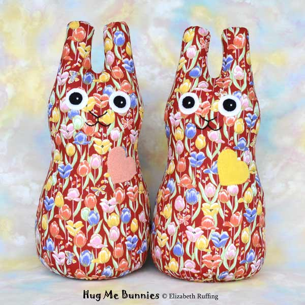 Red, orange, yellow, blue tulip print Hug Me Bunny rabbit art toys by Elizabeth Ruffing