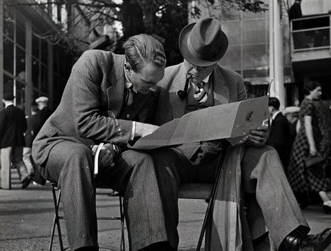 Paris International Exposition: men reading, 1937