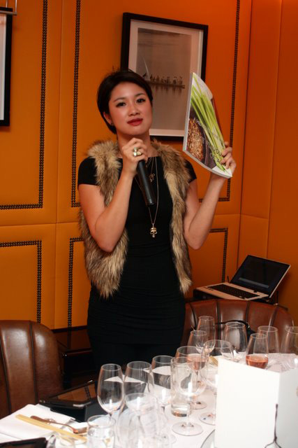Jane Dee, Regional Brand Manager (Belvedere, Estates & Wines, Grand Marnier), Moët Hennessy Asia Pacific showing us the new book on pairing wine with Asian food