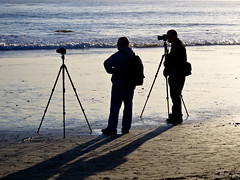 horizon(0.0), walking(0.0), fisherman(0.0), beach(1.0), sand(1.0), sea(1.0), photograph(1.0), ocean(1.0), silhouette(1.0), wave(1.0), shore(1.0), coast(1.0), shadow(1.0),