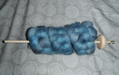 Shetland top, in oh so blue 3oz.  With homemade drop spindle