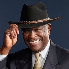Herman Cain wearing a cowboy hat and smiling