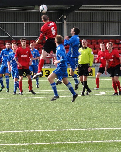 Colin Coates jumps to win the ball