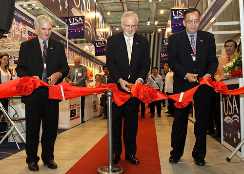 Acting Under Secretary for Farm and Foreign Agricultural Services Michael Scuse, U.S. Ambassador to Vietnam David Shear, and Consul General An Le of the U.S. Consulate in Ho Chi Minh City cut the ribbon to open the USDA-endorsed USA Pavilion at the Food and Hotel Vietnam trade show in Ho Chi Minh City on Sept. 28, 2011. The USA Pavilion was the largest ever at this trade show, featuring 28 U.S. companies representing a wide variety of agricultural goods and products. Scuse is in Vietnam leading USDA's first-ever agricultural trade mission there. Photo by Le Sy Hoang Chuong