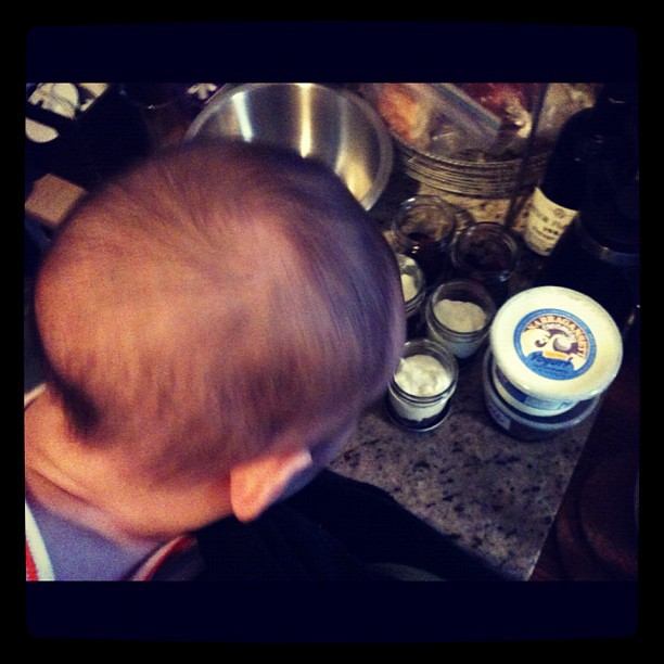 Helping mommy prep yogurt and fruit for the week