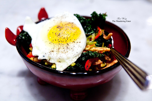 Crispy pigs ears with crispy kale, pickled cherry peppers and fried egg