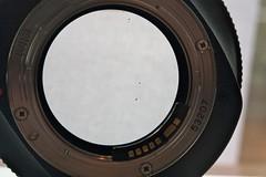 automotive tire(0.0), window(0.0), wheel(0.0), porthole(0.0), rim(0.0), fisheye lens(0.0), camera lens(0.0), eye(0.0), tire(1.0), teleconverter(1.0), lens(1.0), circle(1.0),