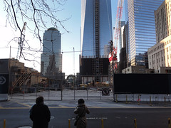 People look upon One World Trade Center under construction