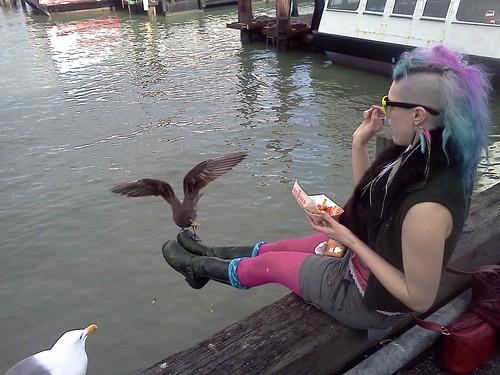 Tess feeding birds off her feet