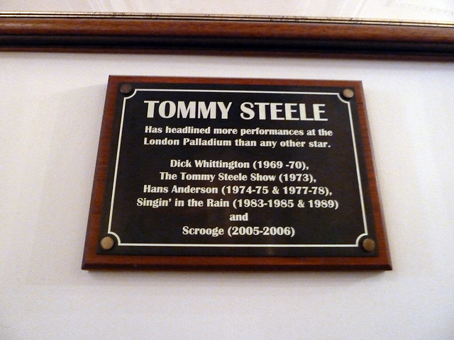 Tommy Steele black plaque - Tommy Steele Has headlined more performances at the London Palladium than any other star. Dick Whittington (1969-70), The Tommy Steele Show (1973), Hand Anderson (1974-75 & 1977-78), Singin' in the Rain (1983-85 & 1989) and Scrooge (2005-2006)