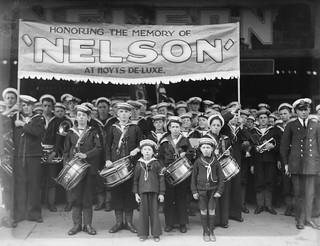 "Naval League cadets in uniform march to Hoyts De Luxe Cinema, George Street, Sydney for the film ""Nelson"", 4 August 1928 / photographer Sam Hood"