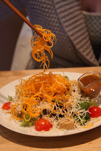 Green Elephant: spicy green leaves salad with spicy bean curd dressing, crispy tofu, topped with crispy rice noodles