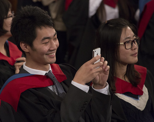 Student taking a photo with his phone