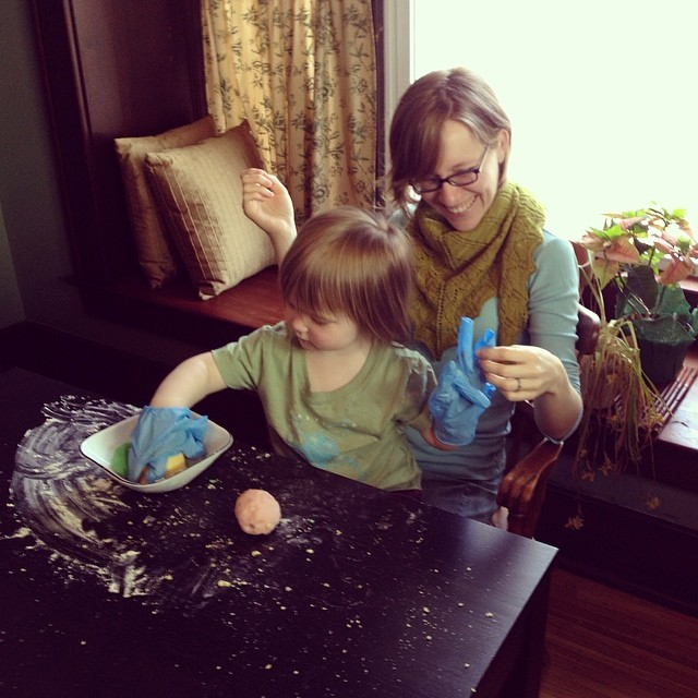 Making playdough with M at her friend's birthday party. She put a lot of flour in my lap! :)