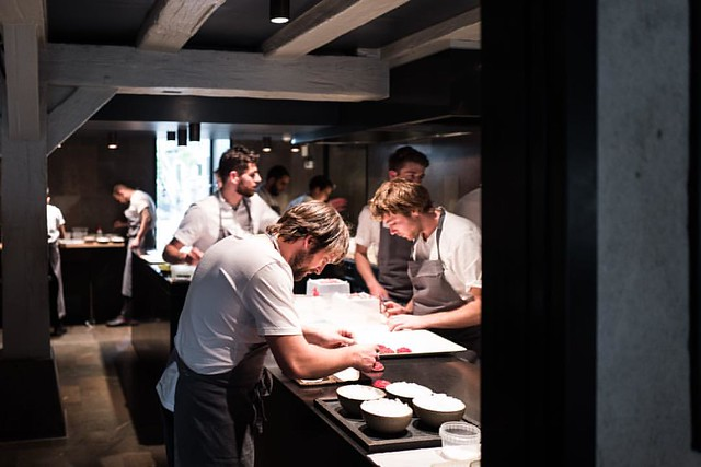 From the minute service kicks off, it's intense in there. There's so much focus and organization. It almost feels like you're watching a team go into one of the biggest matches of the season. Here, Redzepi plates up the rhubarb dish. This is my last post