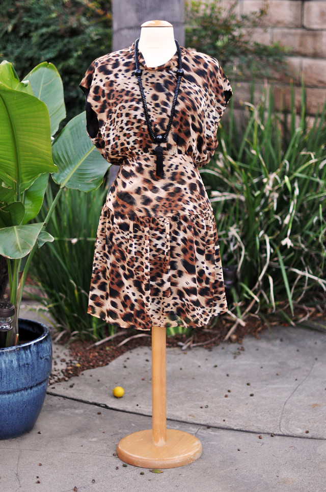 leopard print dress with tassel necklace