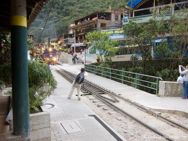 Peru Rail train pulls through Aguas Calientes