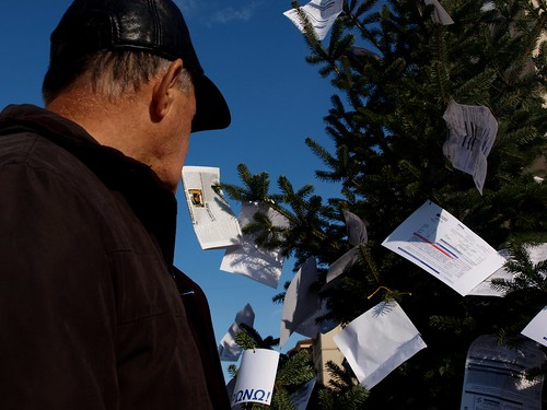 Greek protesters decorate Christmas tree with electricity bills with latest tax hike by Teacher Dude's BBQ