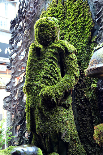 moss covered Buddha statue in Osaka by M. TANIGUCHI