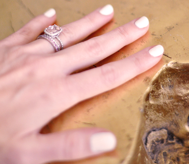 white nails-hand -rings - gold table