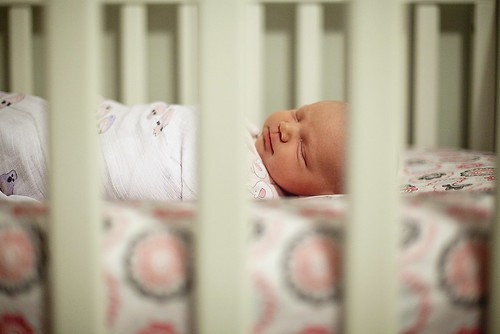 Sleeping in her crib . . .