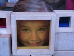 GirlPeepingThruFrame by Lyme Nursery