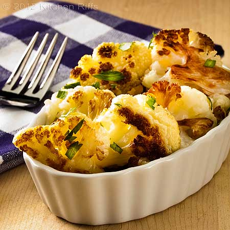 Roast Cauliflower with parsley garnish in White Oblong Ramekin, napkin and fork in background