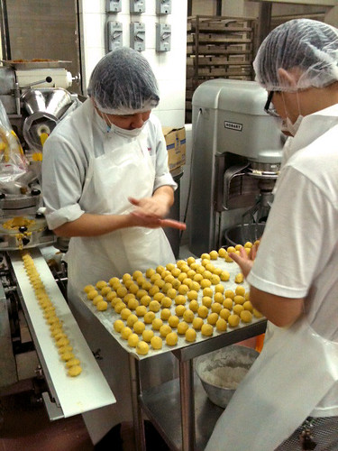 The round pineapple tarts are finished by hand