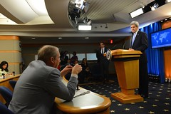 U.S. Secretary of State John Kerry listens to a question from AP reporter Matt Lee after the Secretary's remarks on World Press Freedom Day at the top of the Daily Press Briefing at the U.S. Department of State in Washington, D.C., on May 3, 2016. [State Department Photo/Public Domain]